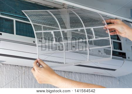 Dirty Filter Of Air Conditioner In Female Hands