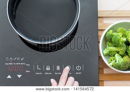 Woman Select Function On Induction Stove