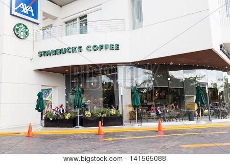 Starbucks Entrance At Downtown Of Cancun City. Starbucks Is The Largest Coffeehouse Company In The W