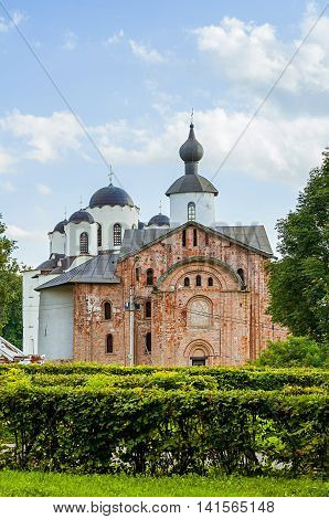Paraskeva Pyatnitsa church and St Nicholas cathedral at Yaroslav Courtyard in Veliky Novgorod Russia. Closeup architecture view in cloudy summer weather