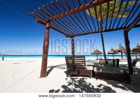 Luxury Wooden Lounge Bed On Caribbean Beach