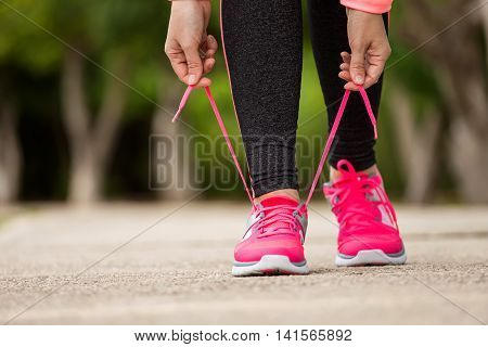 Fitness Woman Tying Running Shoe Laces, Ready For Jogging In Summer Park