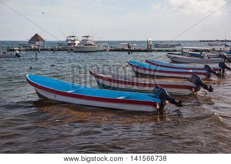 Fishing Motor Boats Moored To Tropical Beach
