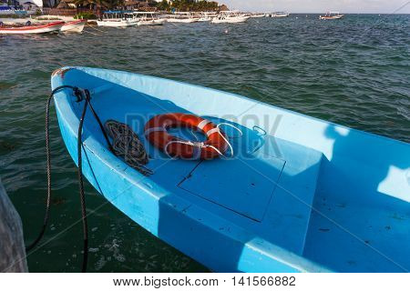 Fishing Boat With Round Lifebuoy At The Sea