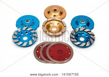 Industrial turbo concrete grinding steel wheels set on white background