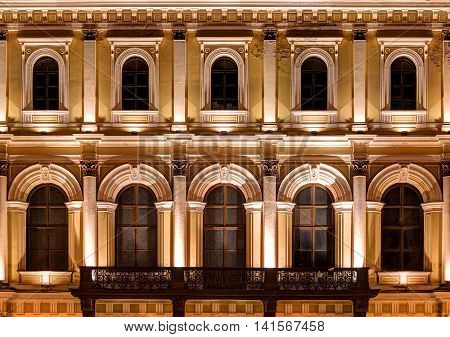 St. Petersburg Russia - May 31 2016: Several windows in a row and balcony on nignt illuminated facade of N.I.Vavilov Institute of Plant Genetic Resourses front view
