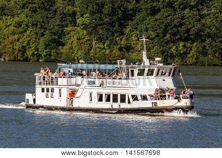 Cruising Ship Full Of People On Danube River
