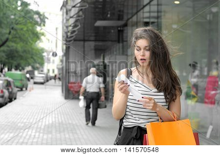 Girl Looks At The Purchase The Check