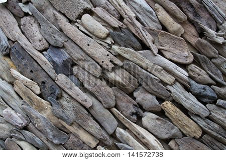 An abstract background made from pieces of old and distressed driftwood and arranged in a diagonal pattern that provides lots of texture and contrast.