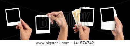 Collection of instant photo frame in hand holding isolated on black background.