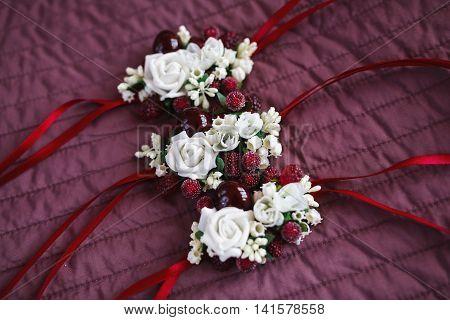 Wedding bracelets for bridesmaids on the burgundy blanket