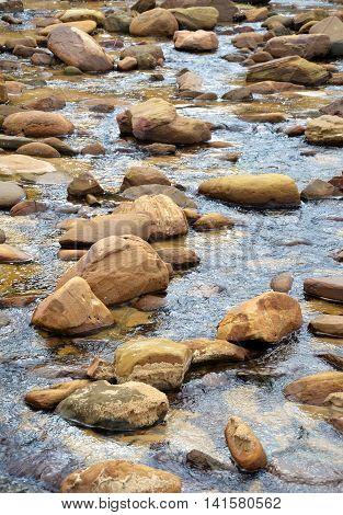 Sandstone boulders in a sandy freshwater creek