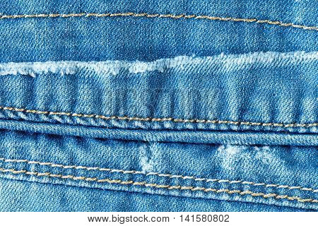 Blue jeans texture with seams can be used for background