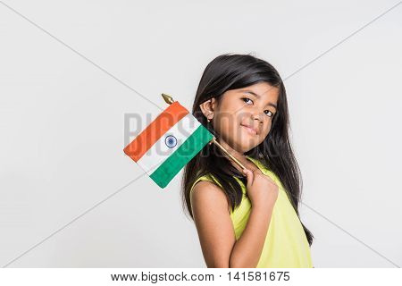 cute little indian girl holding indian flag