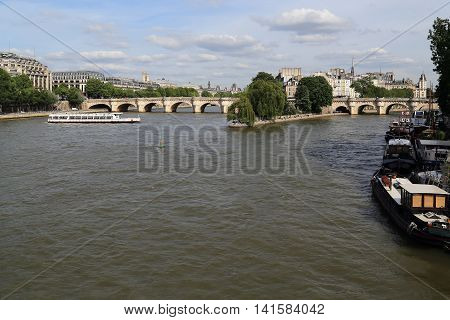 PARIS, FRANCE - MAY 12, 2015: This is view of the historical center of Paris island Cite from the Seine river.