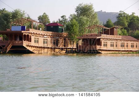 Traditional houseboats on Nagin lake in Srinagar in Kashmir, India