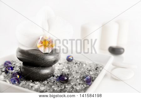 Spa composition on white background - orchid stones candles