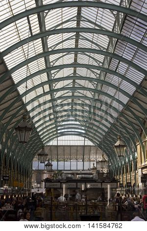 LONDON, UNITED KINGDOM - SEPTEMBER 12 2015: People in Covent Market covered roof in London United Kingdom