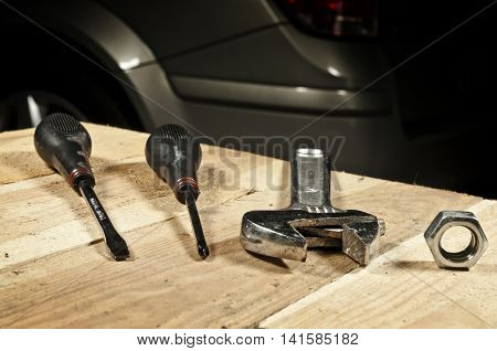 Car mechanic tools: screwdriver wrench lying on a table in a garage
