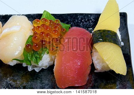 Chromatic Nigiri Sushi,salmon roe, medium fatty tuna,Herring roe.