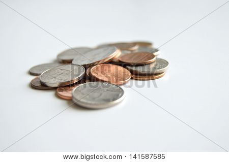 Pile of U.S. coins on a white background.