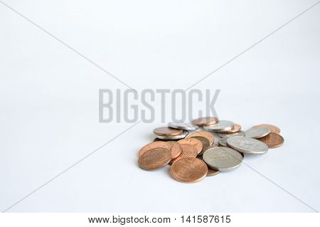 Single pile of U.S. coins lower right.