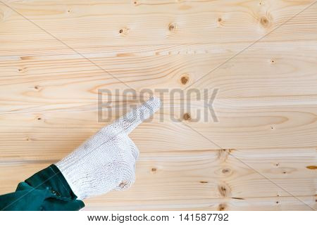 Hand In Gloves Showing On Defects On Tongue And Groove Planks