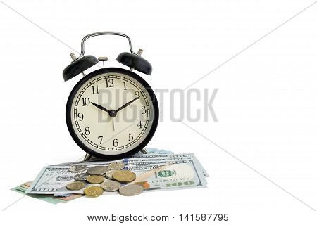 Isolated object black vintage antique alarm clock on dollar money cash and coins isolated on white background - business concept of time and financial management
