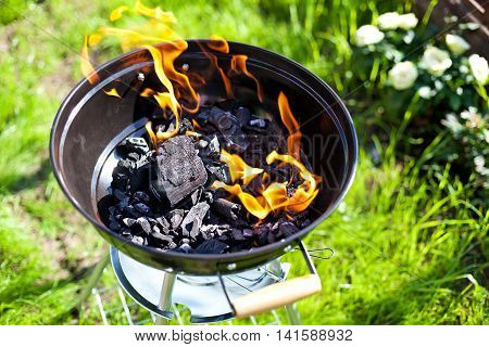 Hot burning charcoal grill on fire. Closeup