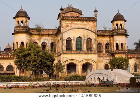Old walls of historical building in Mughal architectural style of Lucknow, India.