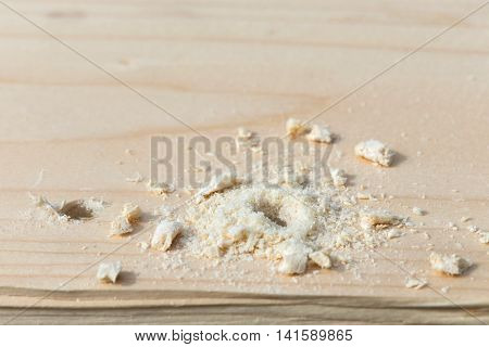 Hole With Sawdust On Wooden Plank
