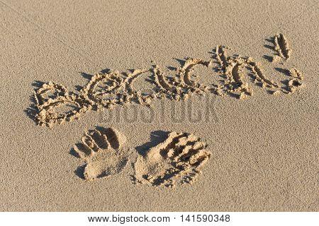 Inscription Beach And Handprints On Sand