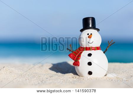 Snowman Toy On White Sandy Beach