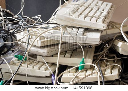 dirty old keyboard, cables for electronic recycling