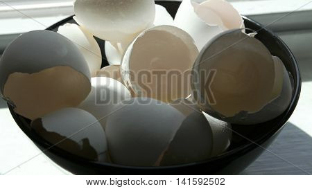 Dynamic closeup of broken eggshells for breakfast.