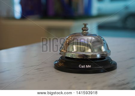 desk bell service for hospitality silver shiny color on marble table in restaurant or hotel