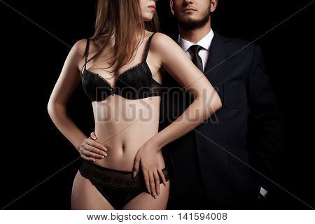 Rich And Powerful Concept. Businessman In Suit Next To Hot Woman In Lingerie