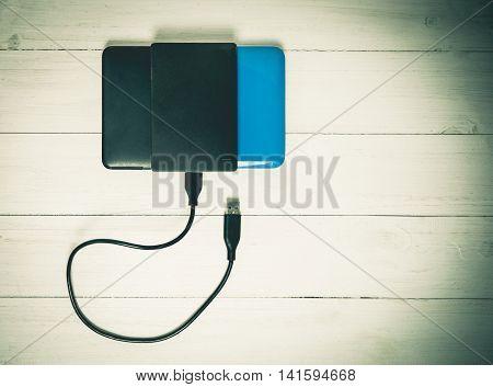 USB External Hard disks on wooden Vintage