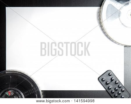 Video Tape film roll with remote control on paper background