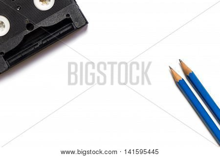 Video Tape and Pencil writing on whtie background