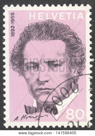 MOSCOW RUSSIA - CIRCA APRIL 2016: a post stamp printed in SWITZERLAND shows a portrait of Oscar Arthur Honegger the series