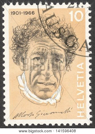 MOSCOW RUSSIA - CIRCA APRIL 2016: a post stamp printed in SWITZERLAND shows a portrait of Alberto Giacometti the series