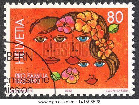 MOSCOW RUSSIA - CIRCA MAY 2016: a post stamp printed in SWITZERLAND shows a family the series