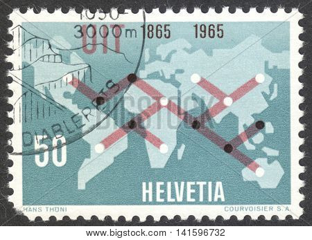 MOSCOW RUSSIA - CIRCA APRIL 2016: a post stamp printed in SWITZERLAND shows world map with symbolic telecommunication connections circa 1965
