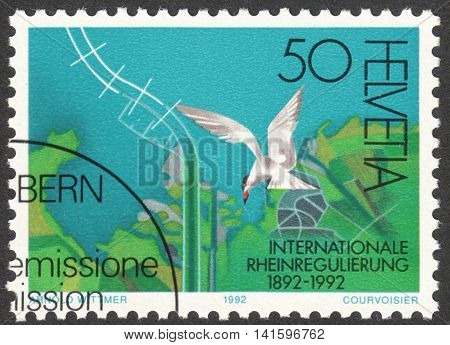 MOSCOW RUSSIA - CIRCA APRIL 2016: a post stamp printed in SWITZERLAND shows an aerial view of the Rhine mouth into the Bodensee dedicated to International Rhine Regulation circa 1992