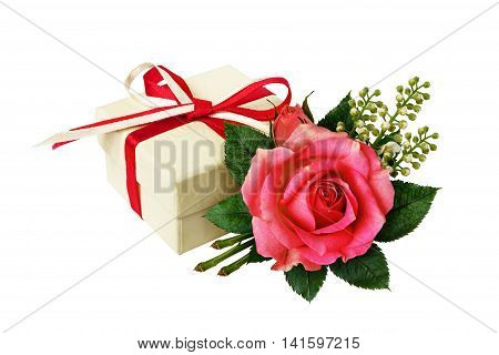 Pink rose flower arangement and a gift on isolated on white
