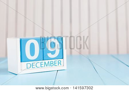 December 9th. Day 9 of month, calendar on wooden background. Winter concept. Empty space for text.