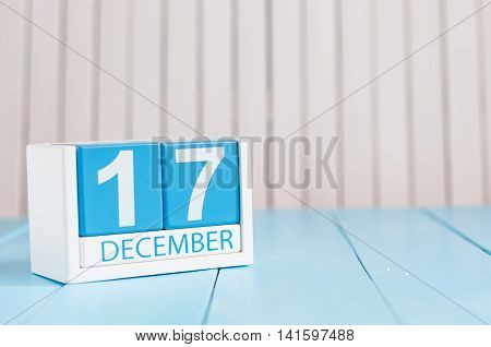December 17th. Day 17 of month, calendar on wooden background. Winter time. Empty space for text.