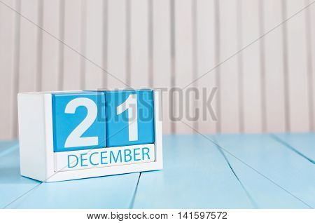 December 21st. Day 21 of month, calendar on wooden background. Winter time. Empty space for text.
