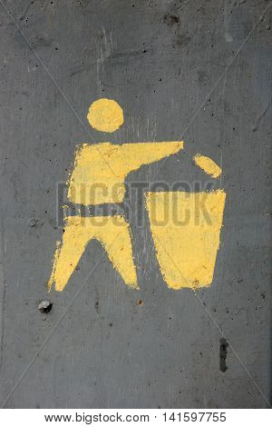 brush icon showing yellow man throwing rubbish in the trash bin